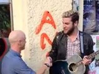 Jimmy Somerville joins in with a busker